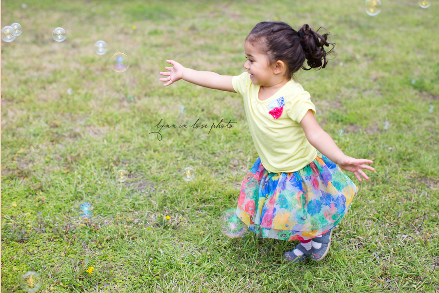 Indian girl with curles chasing bubbles by Lynn in Love Photo, Dallas and Houston Child Photographer
