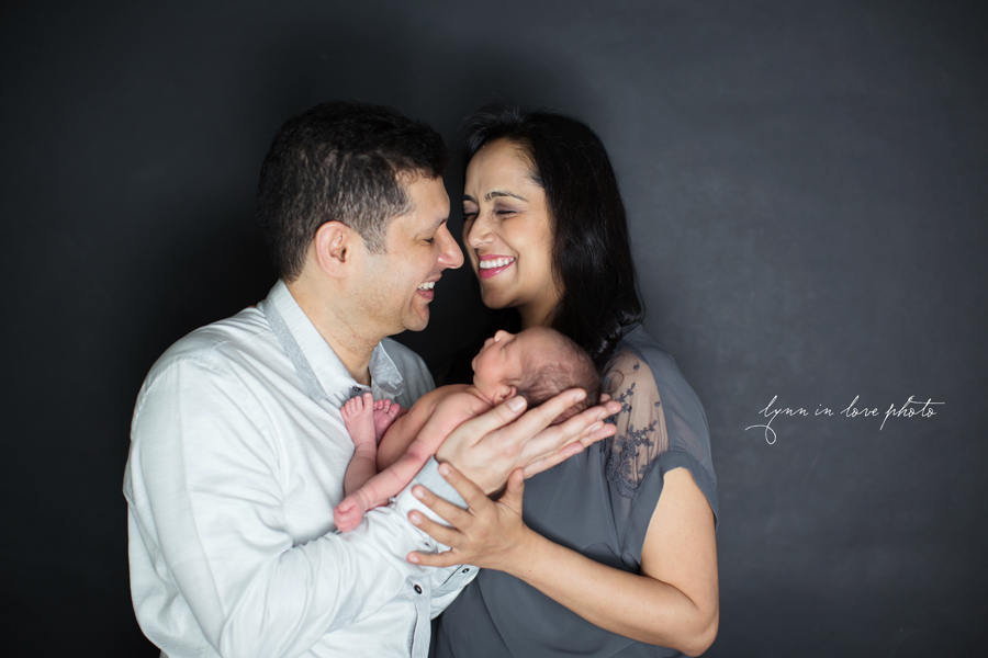Ameya Newborn Session with happy parents by Lynn in Love Photo, Dallas and Houston Newborn Photographer