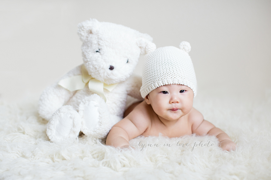 Adorable Asian Cute Asian Baby, Daniel at 4 months old with white bear hat and white teddy bear by Lynn in Love Photo, Dallas and Houston Baby Photographer, Daniel at 4 months old on white fur by Lynn in Love Photo, Dallas and Houston Baby Photographer