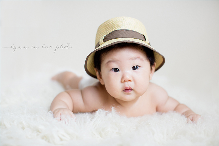 Asian baby boy with cute straw hat by Lynn in Love Photo, Dallas and Houston Baby Photographer