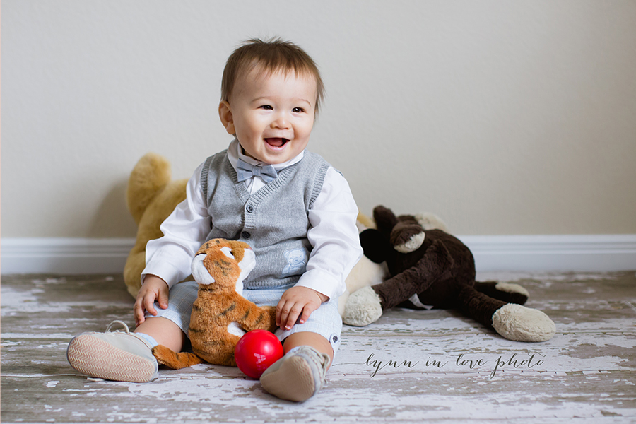 Cute 1 year old baby boy with dapper outfit and his stuffy friends by Lynn in Love Photo, Houston Baby Photographer