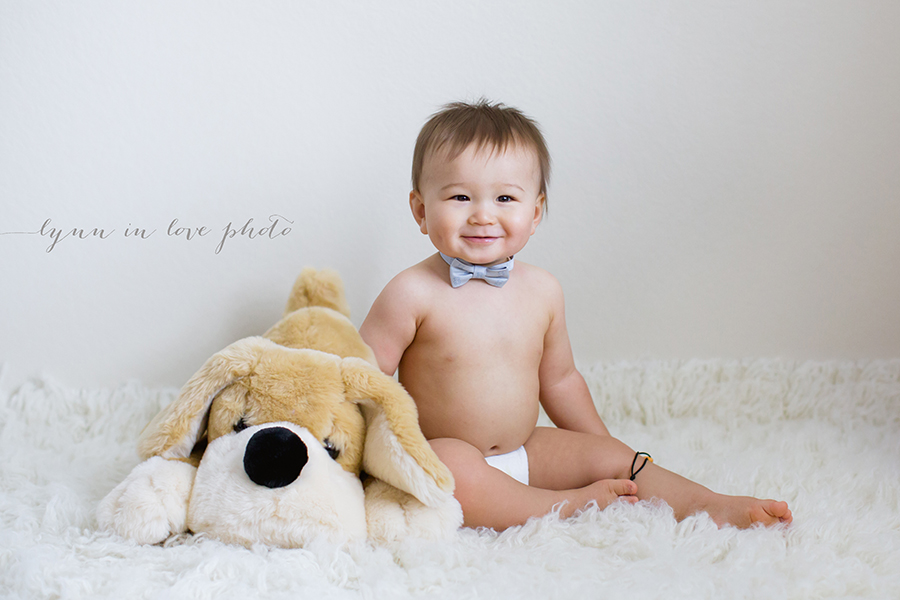 Cute 1 year old baby boy with bowtie and his stuffy friends by Lynn in Love Photo, Houston Baby Photographer